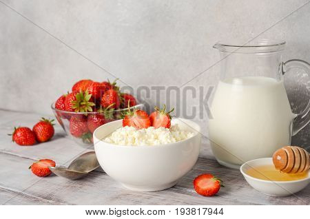 Fresh cottage cheese with fresh strawberries, healthy breakfast concept, selective focus