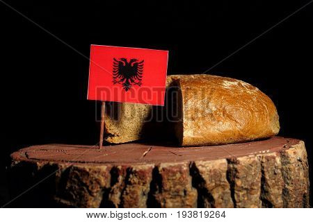 Albanian Flag On A Stump With Bread Isolated