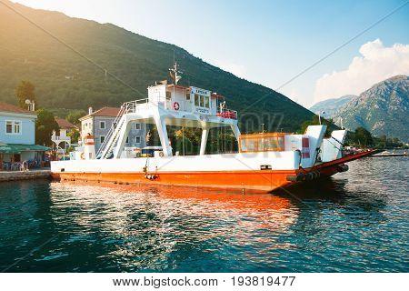 KOTOR, MONTENEGRO - 26.06.2017: Car ferry linking the towns of Herceg Novi and Kotor across the Bay of Kotor, Montenegro