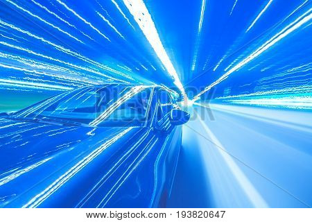 View from Side of Car moving in a night city Blured road with lights with car on high speed.