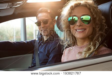 Couple doing test drive in car during test drive