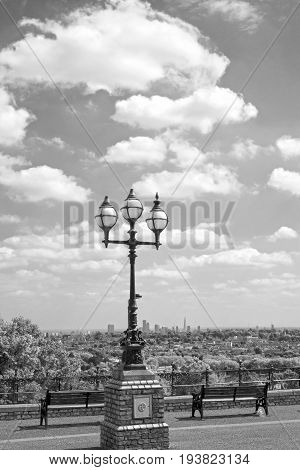 antique street light with a beautiful view of london city