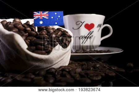 Australian Flag In A Bag With Coffee Beans Isolated On Black Background