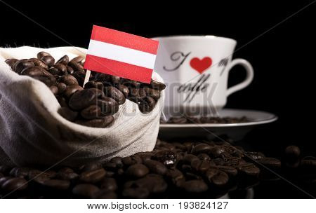 Austrian Flag In A Bag With Coffee Beans Isolated On Black Background