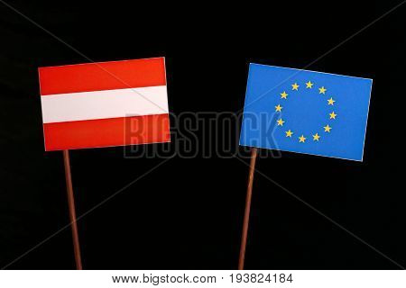 Austrian Flag With European Union (eu) Flag Isolated On Black Background