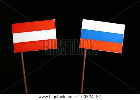 Austrian Flag With Russian Flag Isolated On Black Background