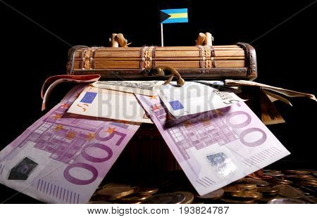 Bahamas Flag On Top Of Crate Full Of Money