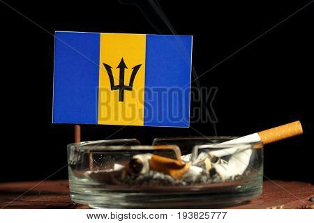Barbados Flag With Burning Cigarette In Ashtray Isolated On Black Background