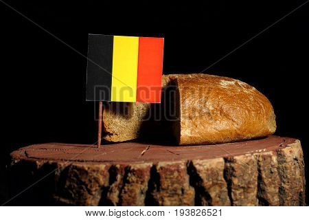 Belgian Flag On A Stump With Bread Isolated