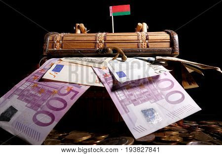 Belarusian Flag On Top Of Crate Full Of Money