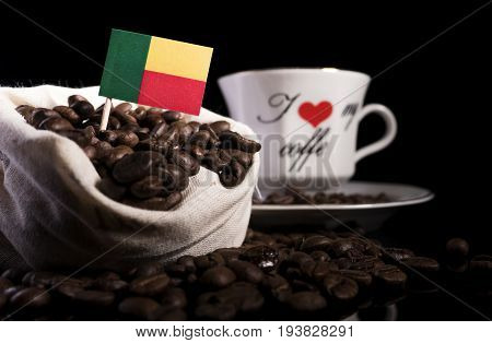 Benin Flag In A Bag With Coffee Beans Isolated On Black Background