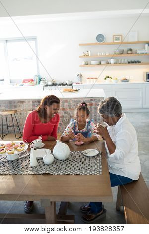 Multi-generation family having breakfast in dining table at home