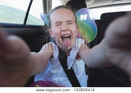 Girl making a facial expression in car