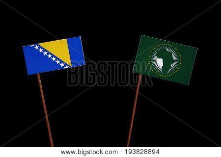 Bosnia And Herzegovina Flag With African Union Flag Isolated On Black Background