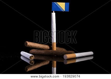 Bosnia And Herzegovina Flag With Cigarettes And Cigars. Tobacco Industry Concept.