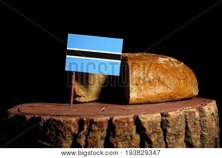 Botswana Flag On A Stump With Bread Isolated