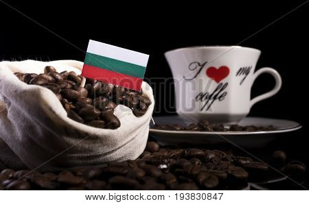 Bulgarian Flag In A Bag With Coffee Beans Isolated On Black Background