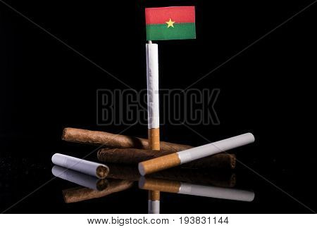 Burkina Faso Flag With Cigarettes And Cigars. Tobacco Industry Concept.