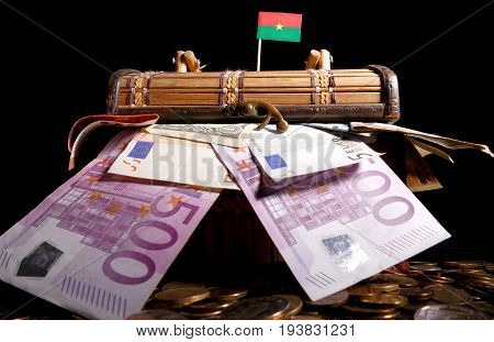 Burkina Faso Flag On Top Of Crate Full Of Money