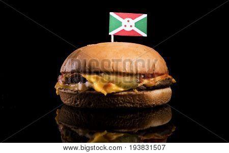 Burundi Flag On Top Of Hamburger Isolated On Black Background