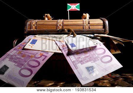 Burundian Flag On Top Of Crate Full Of Money