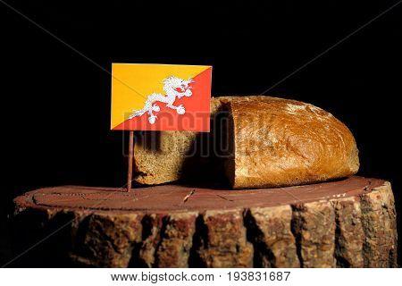 Bhutan Flag On A Stump With Bread Isolated