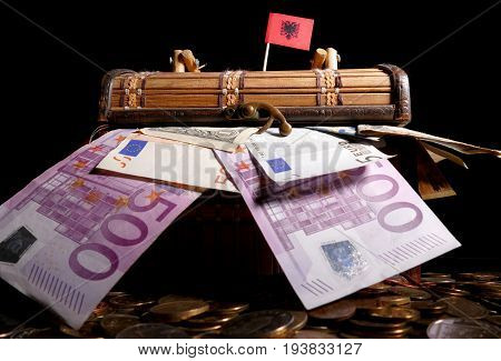 Albanian Flag On Top Of Crate Full Of Money