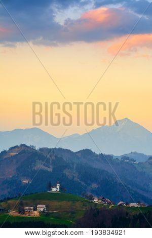 Church on the hill at sunset at near little village Sveti Tomaž Slovenia