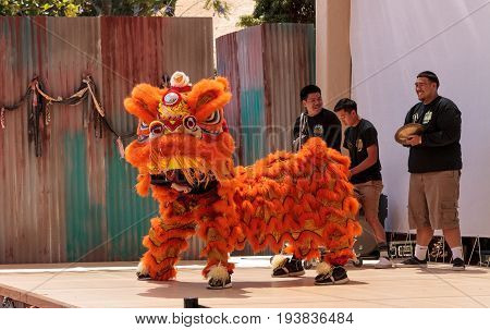 San Diego CA USA - July 1 2017: Chinese lion dance demonstration performed at the San Diego Zoo Safari park. Editorial only.