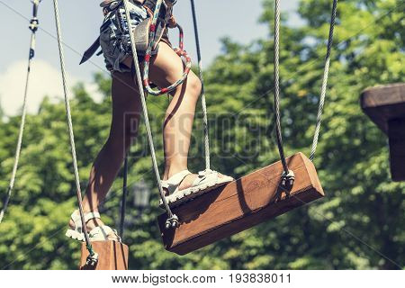 Child climbing on high rope park. adventure climbing high wire park.