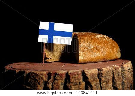 Finnish Flag On A Stump With Bread Isolated