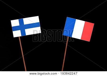 Finnish Flag With French Flag Isolated On Black Background