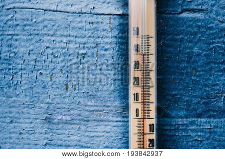 Thermometer On The Old Wooden Wall, Concept Of Hot Weather