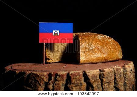 Haitian Flag On A Stump With Bread Isolated