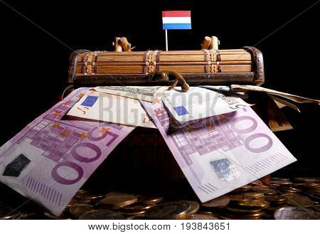 Dutch Flag On Top Of Crate Full Of Money
