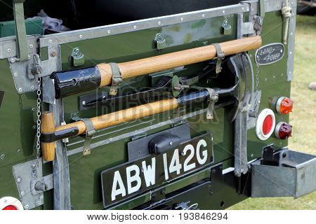 Sandhurst, Uk - June 18 2017: Rear Of A British Army Landrover With Spade And Pickaxe