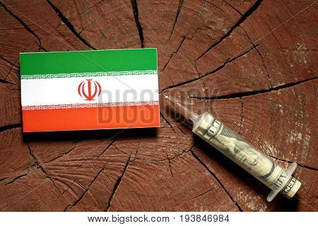 Iranian Flag On A Stump With Syringe Injecting Money In Flag