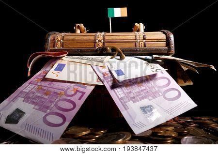 Irish Flag On Top Of Crate Full Of Money