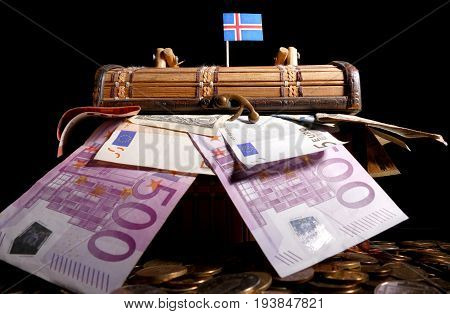 Icelandic Flag On Top Of Crate Full Of Money