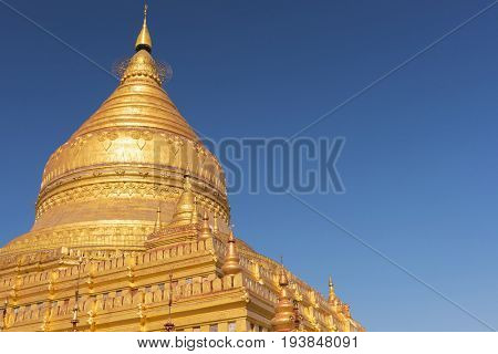 Detail of Shwezigon Pagoda which is one of the oldest sacred golden buddhist pagoda in Myanmar. Town of Nyaung-U near ruins of Bagan,  Myanmar