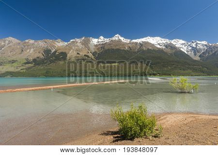 Beautiful lake Wakatipu with mighty mountains at Glenorchy. Otago region, New Zealand