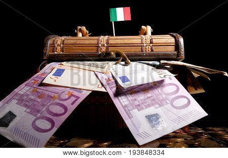 Italian Flag On Top Of Crate Full Of Money