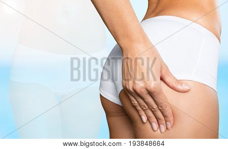 Woman buttocks check cellulite cosmetic surgery fat cells skin fold test