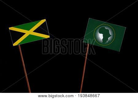Jamaican Flag With African Union Flag Isolated On Black Background