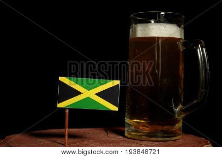 Jamaican Flag With Beer Mug Isolated On Black Background