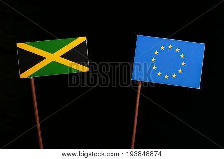 Jamaican Flag With European Union (eu) Flag Isolated On Black Background