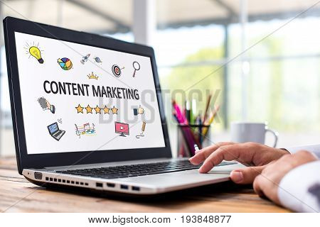 Content Marketing Concept With Various Hand Drawn Doodle Icons On Laptop Monitor