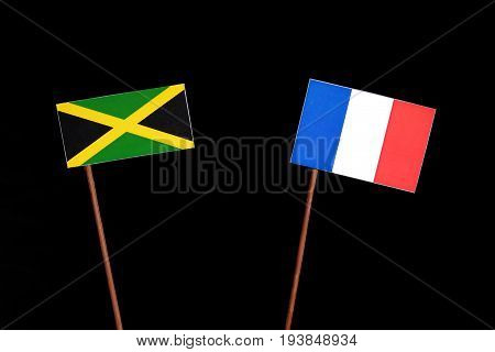 Jamaican Flag With French Flag Isolated On Black Background