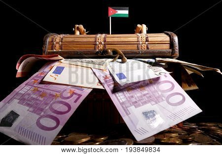 Jordanian Flag On Top Of Crate Full Of Money
