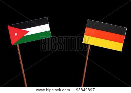 Jordanian Flag With German Flag Isolated On Black Background